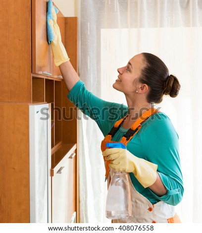smiling professional European cleaner  cleaning the office - stock photo