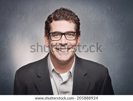 Smiling professional man with glasses portrait