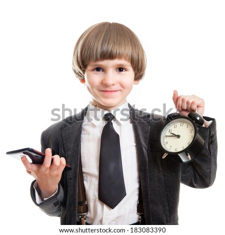 smiling pupil with alarm and smartphone - stock photo