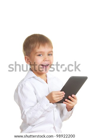 Smiling reading boy with electronic book. Isolated on white - stock photo