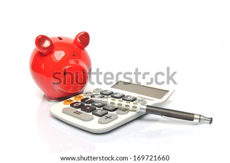 Smiling red piggy bank with calculator and ball pen  - stock photo