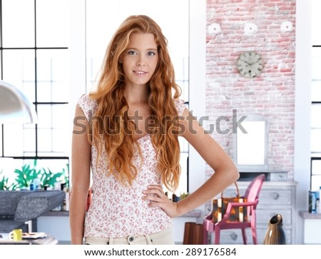 Smiling redhead woman posing for portrait at home. - stock photo