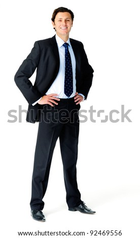 Smiling relaxed businessman poses for a full length portrait, isolated on white