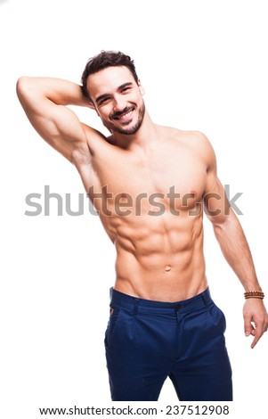 smiling relaxed model man with healthy atletic body on white background - stock photo