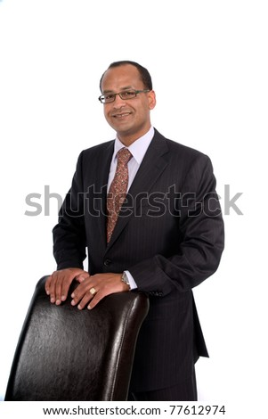 Smiling Sales Representative poses with leather chair.