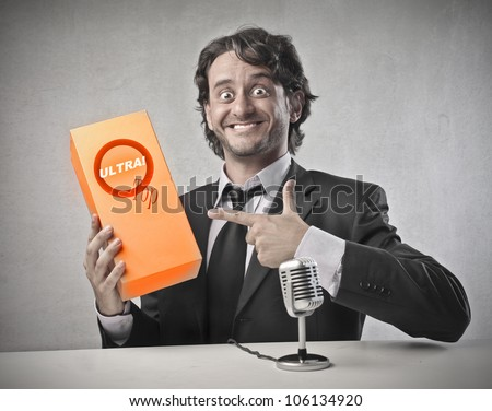 Smiling salesman advertising a product - stock photo