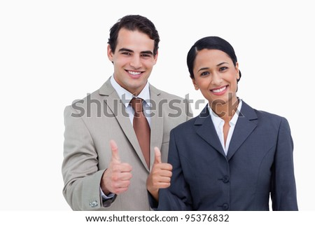 Smiling salesteam giving approval against a white background