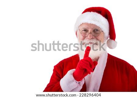 Smiling Santa Claus making silence gesture - stock photo