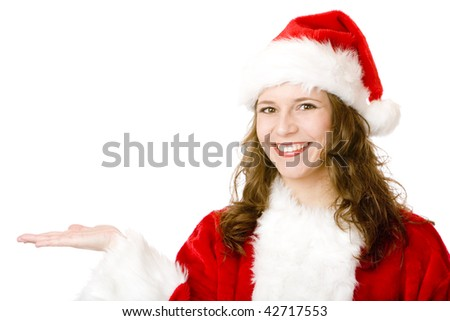 Smiling Santa Claus woman holding one hand with free space for an advertisement sign. Isolated on white.