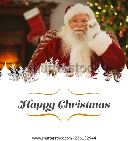 Smiling santa holding his glasses against border - stock photo