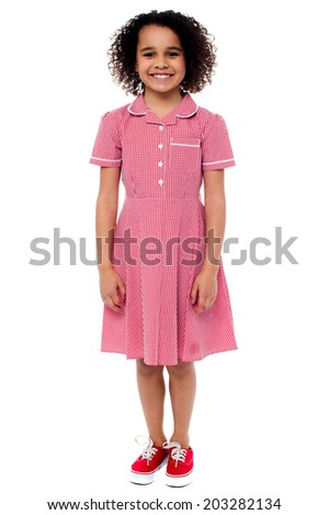 Smiling school girl in pink uniform - stock photo