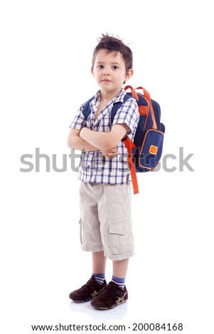 Smiling school kid standing with arms crossed against white background - stock photo