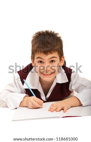 Smiling schoolboy doing homework isolated on white background