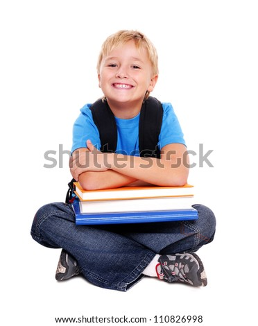 Smiling schoolboy sitting on the floor - stock photo