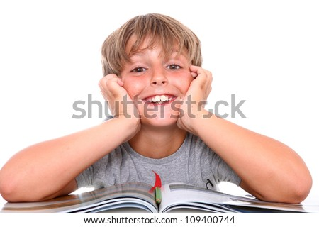 Smiling schoolboy with book