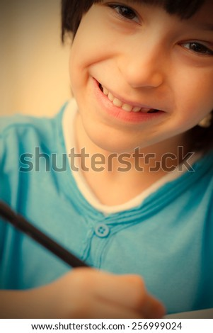 smiling schoole boy with pen, portrait. instagram image retro style - stock photo