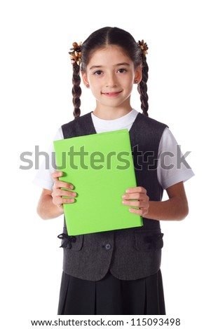 Smiling schoolgirl standing with blank color book in hands, isolated on white - stock photo