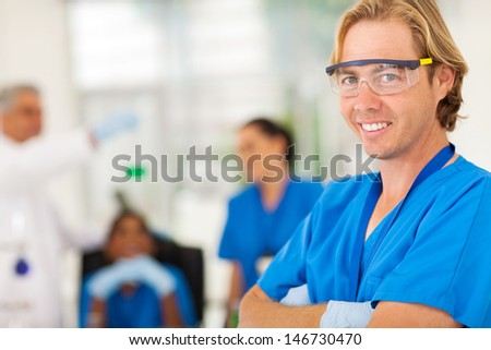 smiling scientist in the lab - stock photo
