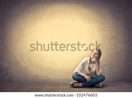 Smiling seated teenage girl