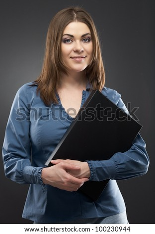 Smiling secretary with black paper folder isolated portrait against gray background. [ studio  portrait] - stock photo