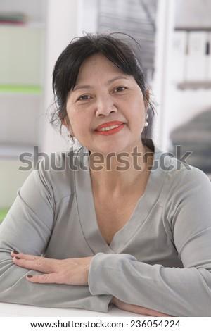 Smiling senior asian thai  woman portrait - stock photo