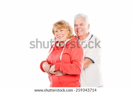 Smiling senior couple in love. Isolated on white background. - stock photo
