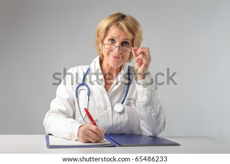 Smiling senior doctor - stock photo