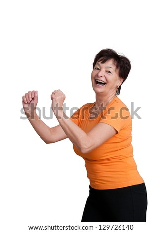 Smiling senior fitness woman exercising - isolated on white - stock photo