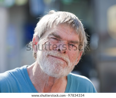 Smiling senior man outdoors during the daytime - stock photo