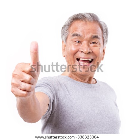 smiling senior old man showing thumb up gesture - stock photo