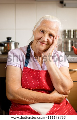 Smiling senior woman in the kitchen