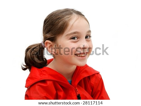 Smiling seven years girl with pigtails