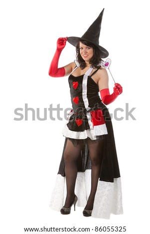 smiling sexy girl in Halloween witch with wand - stock photo