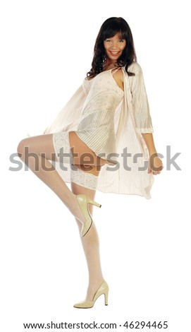 smiling sexy girl in sleepwear dress posing isolated on white