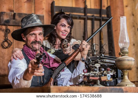 Smiling Sheriff Stands With Woman and a Loaded Gun - stock photo