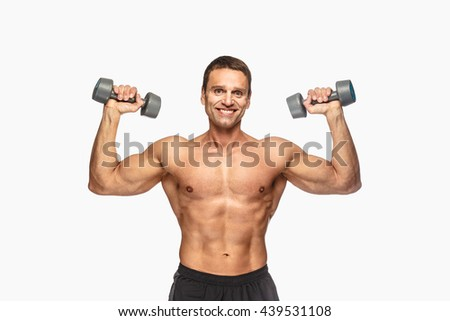 Smiling shirtless male with dumbbells isolated on white background. - stock photo