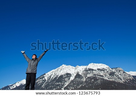 smiling skier on top of the mountains