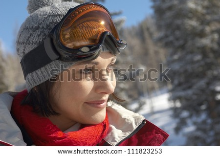 Smiling skiing woman