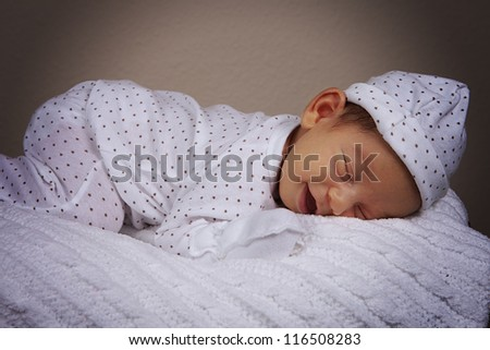 Smiling sleeping baby boy with pajamas