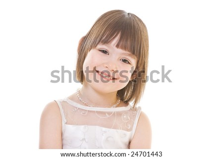 Smiling small girl well-dressed in white - stock photo