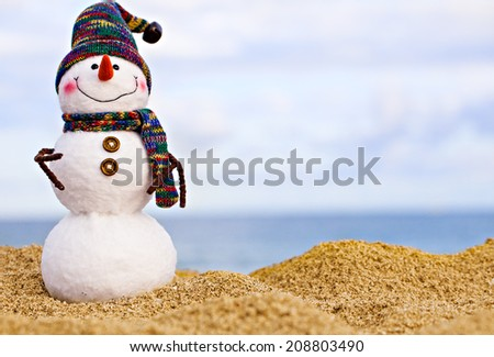 Smiling snowman on the sea beach. Summer holidays concept - stock photo