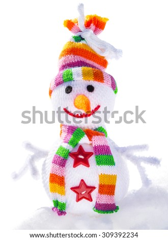 Smiling snowman on the snow isolated on white background