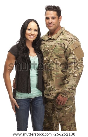 Smiling soldier embracing his wife against white background - stock photo