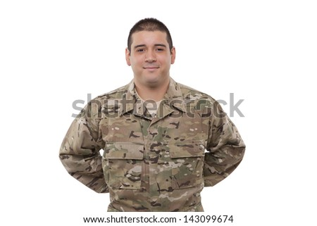 Smiling  soldier with hands behind back  - stock photo