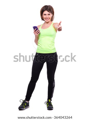 smiling sport woman with mobile and with her thumb up - stock photo