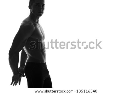 Smiling sporty man isolated on white