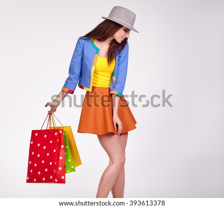 Smiling spring woman with shopping bags - stock photo
