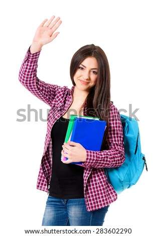Smiling student girl with bag greets with her hand, isolated on white background - stock photo