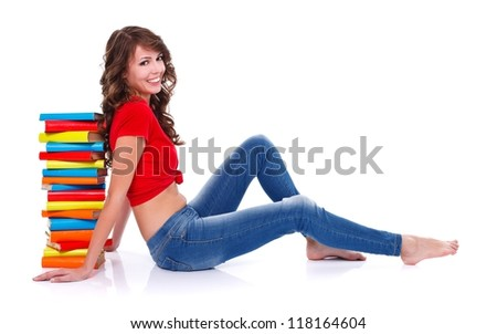 Smiling student girl with notebooks over white background - stock photo