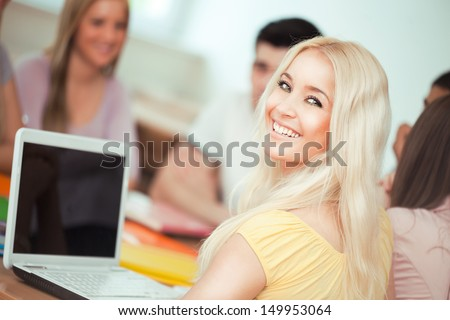 Smiling student in computer science class. - stock photo